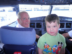 My son in the cockpit with the USA3000 Airlines captain.