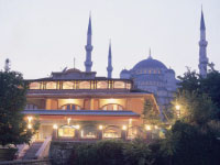 Our charming hotel, Sultanahmet Palace, is the one in front with the lights on.