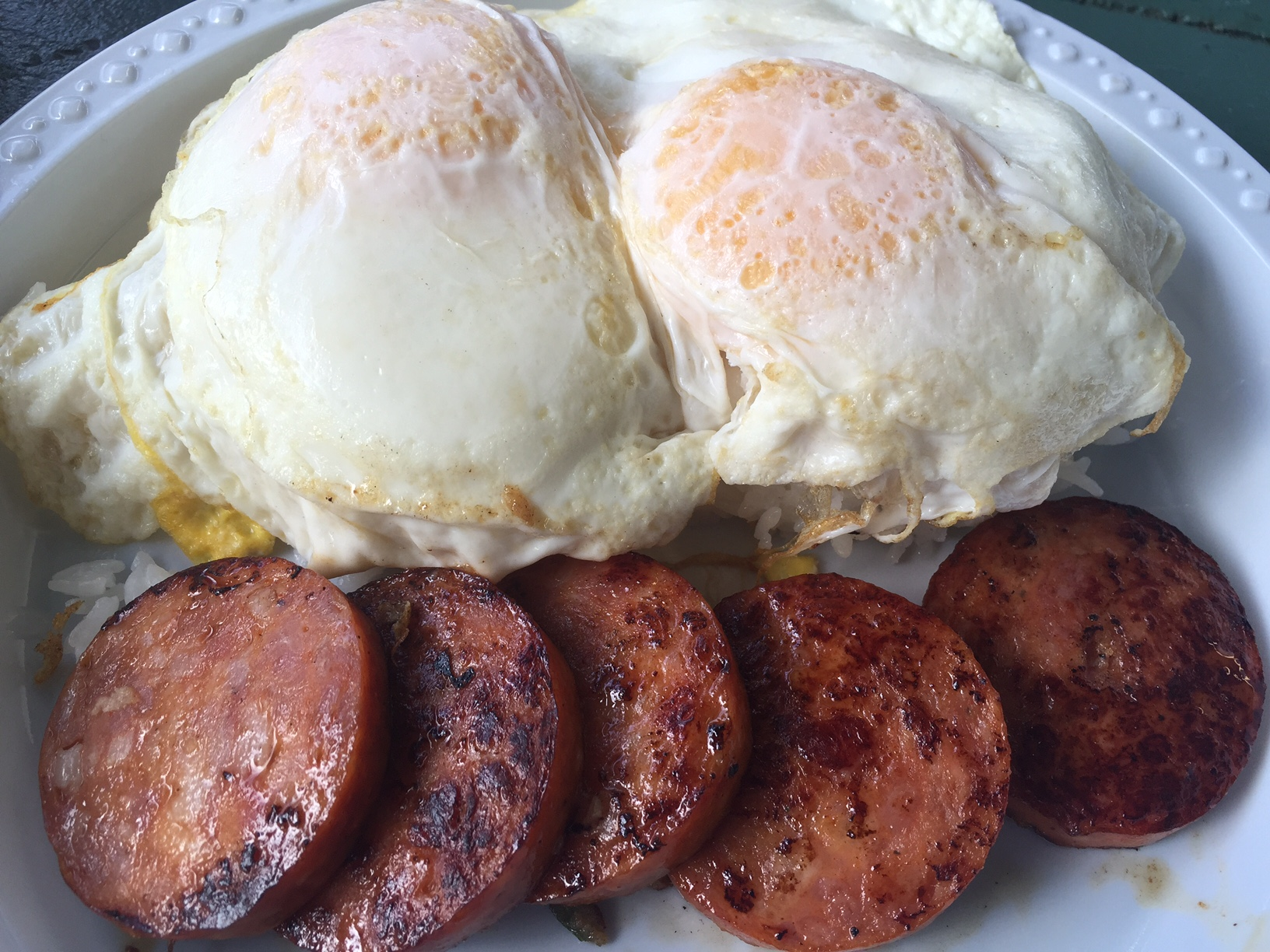 Rainbow Drive-In (Oahu): The Obamas always visit Hawaii for their Winter Break (I swear, we weren't secretly vacationing with them), and one of Barack's favorite places is Rainbow Drive-In. Here's a traditional breakfast of fried eggs over rice with Portuguese sausage.